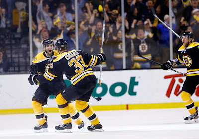 Patrice Bergeron and Zdeno Chara celebrate Bergeron's game winning and series winning goal