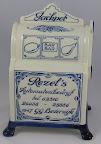 """Is van """" 't Delftsche Huys '' Delft blue handwork made in Holland in opdracht van rezel b.v ."""