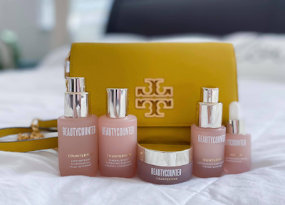tory burch bag with countertime skincare line with retinatural formula
