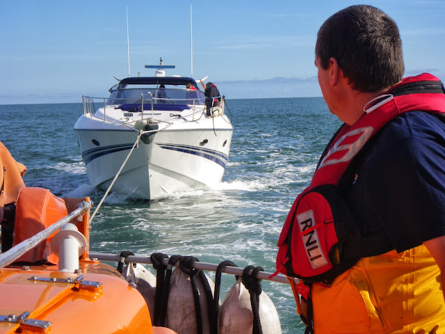 Poole lifeboat Crew Member Ade monitoring the tow rope from Poole ALB 6 October 2013 Photo: RNLI Poole/Anne Millman