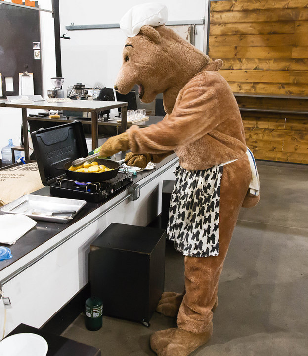 photo of bear cooking potatoes