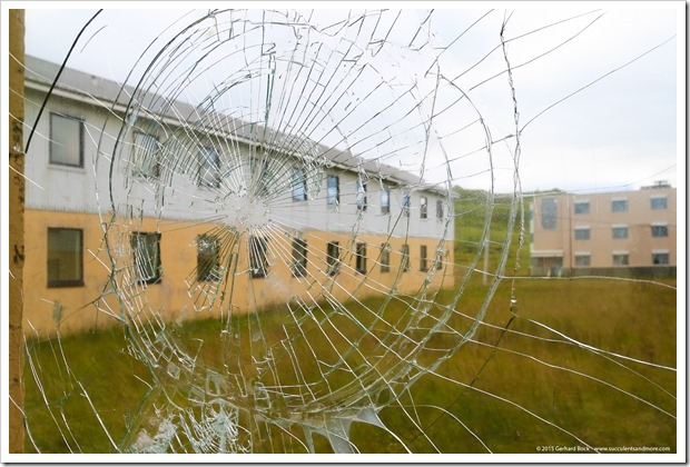 150906_Adak_barracks_broken_window_WM