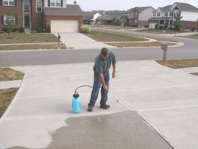 Sealing A Concrete Driveway By Jaco In Lexington, Kentucky.
