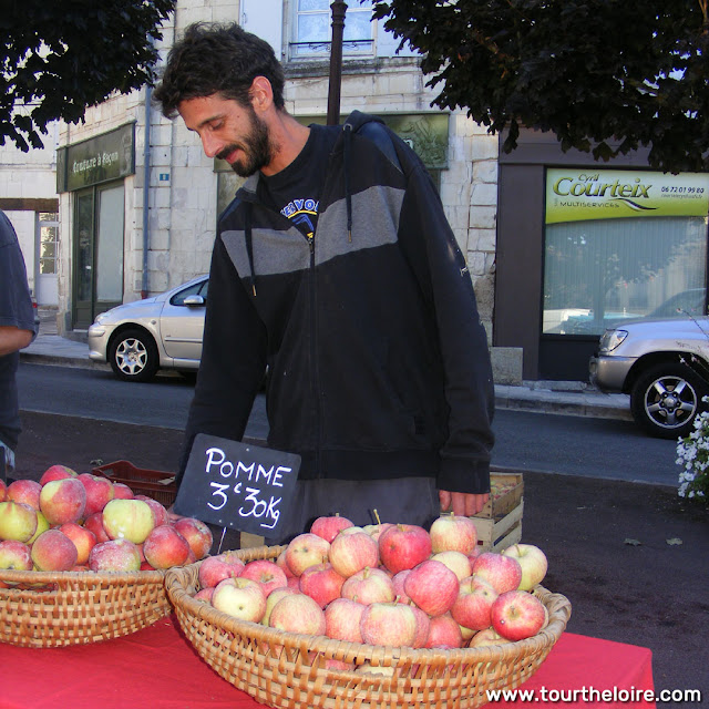 Apple orchardist at a market, Indre et Loire, France. Photo by Loire Valley Time Travel.