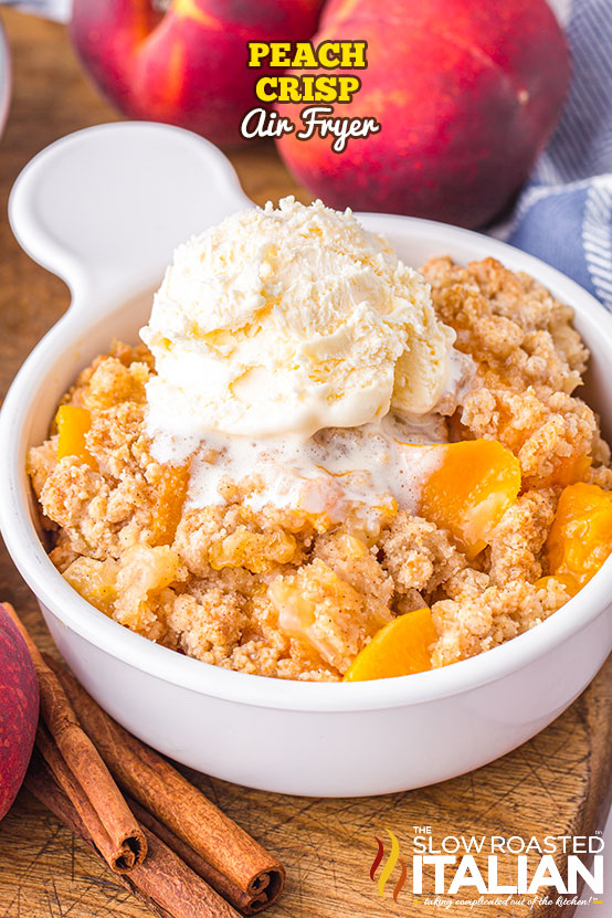 Peach Crisp (Air Fryer) in a bowl with ice cream on top