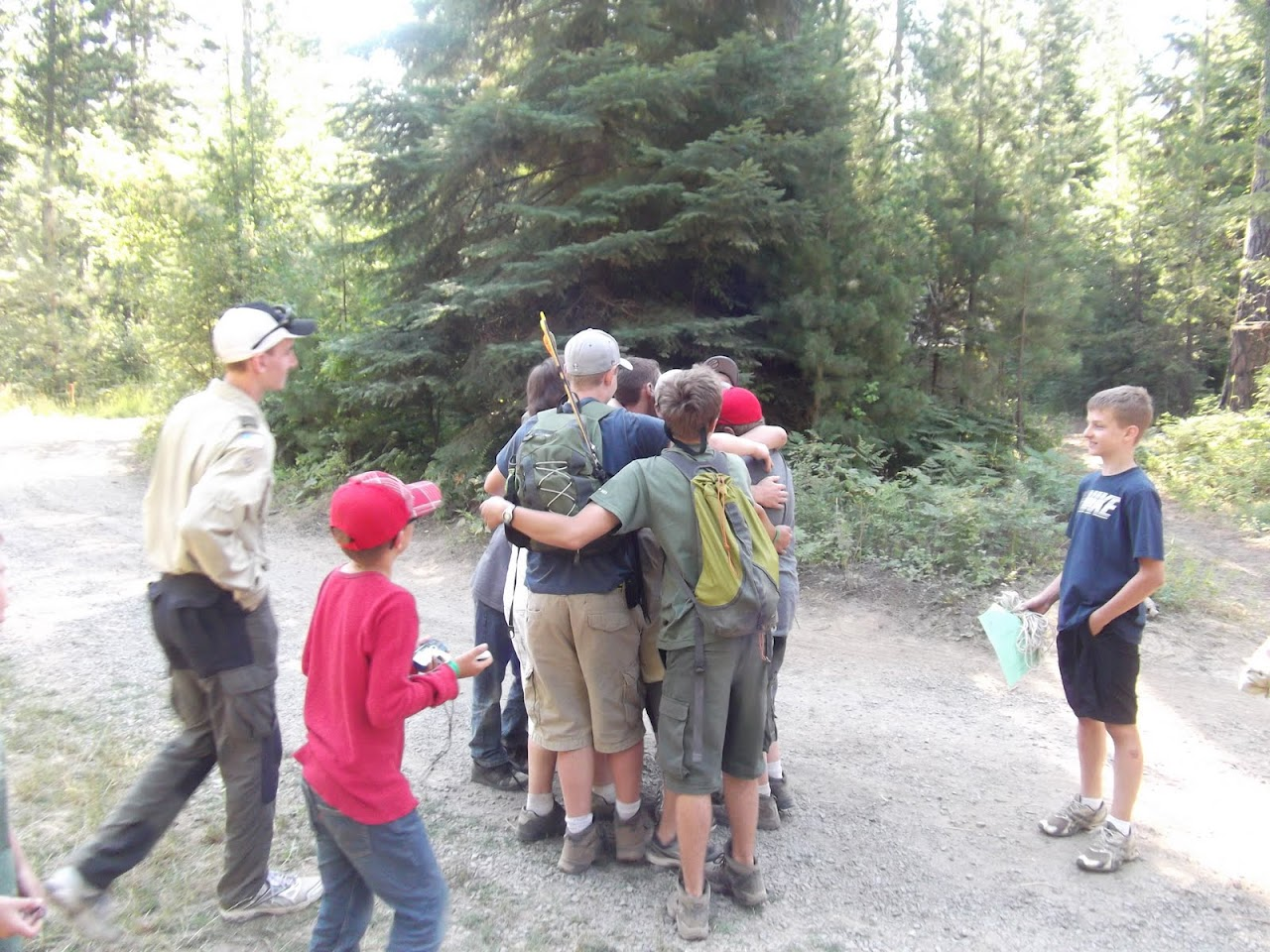 Group hug around Butter Cup -- our camp staff person.