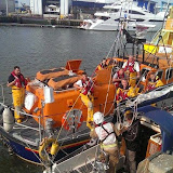 Poole ALB crew alongside Poole Quay, working with the Dorset Fire and Rescue Service to check out a yacht with an overheated engine 19 May 2014 Photo: Danny Hawkes