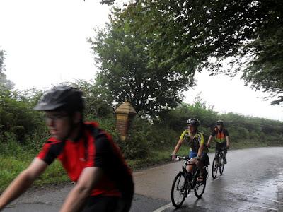 Three cycling past
