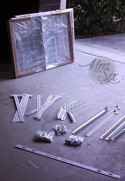 Assembling overhead garage storage rack