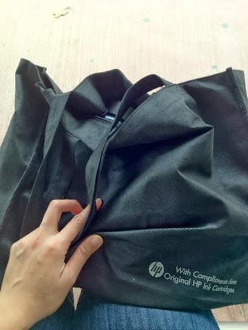 black woven bag, complimentary copy