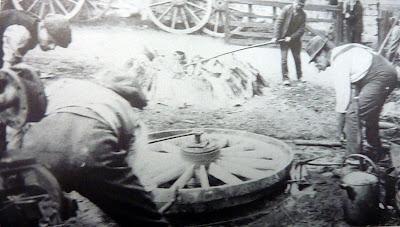 Men at work in the blacksmith's workshop, Hauxton Road, Little Shelford