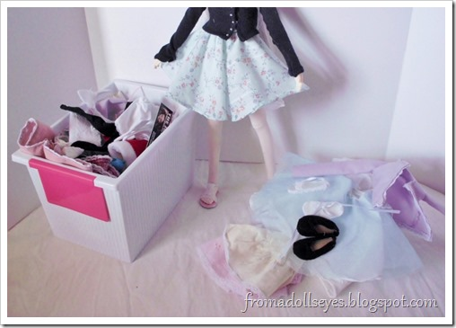 Organizing doll stuff.