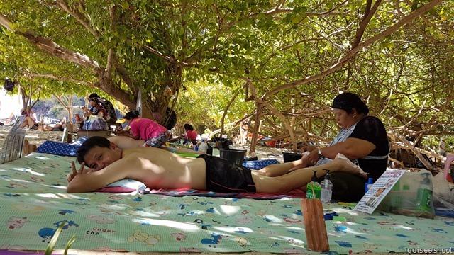 Massage services at Phra Nang Beach, Railay Peninsula.