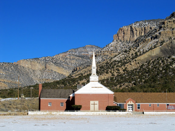 "Baptist church in Sunnyside, with the ""E.C."" visible on the mountain to the right of the steeple"
