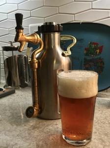 Growlerwerks µKeg behind a pint of beer