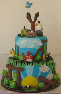 Angry birds custom unique 3 tier fondant birthday cake design with edible birds, pigs, slingshot, eggs and nest