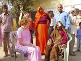 Jyoti, General Secretary of VRI, talks to a villager after her successful cataract operation.