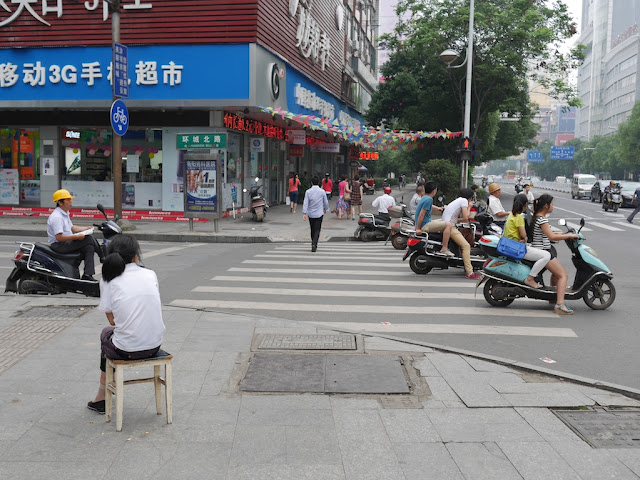 woman sitting on a stool in Hengyang, Hunan, China