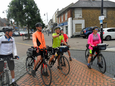 5 cyclists in town