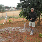 Chuck watering his front yard