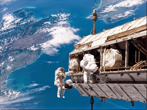 Spacewalk Outside the International Space Station, STS-116.jpg