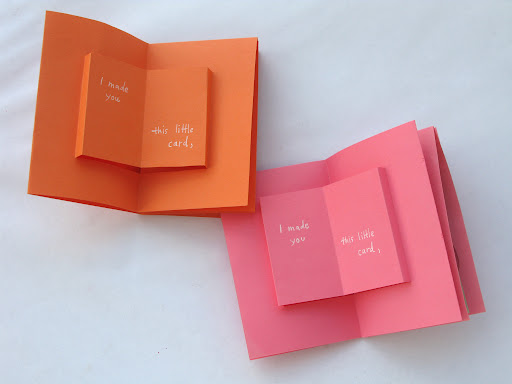 first page of the cards has a simple pop-up, made by making 2 horizontal cuts. (a card within a card!)