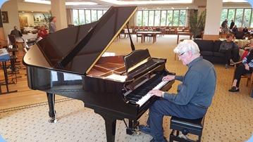 Resident, Bennie Gunn, playing the grand piano.