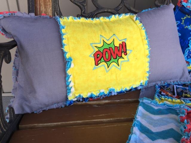 Superhero themed throw pillow with Pow embroidery
