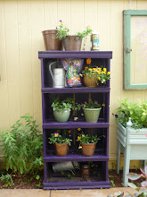 Photo: These shelves hold tools, fertilizers, and flower pots, but can be quickly cleared off for drinks and serving trays at parties