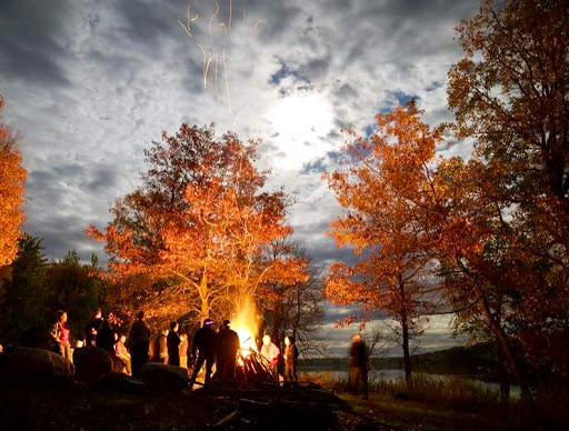 Chris Miller photography capture of bonfire under full moon Sunday night