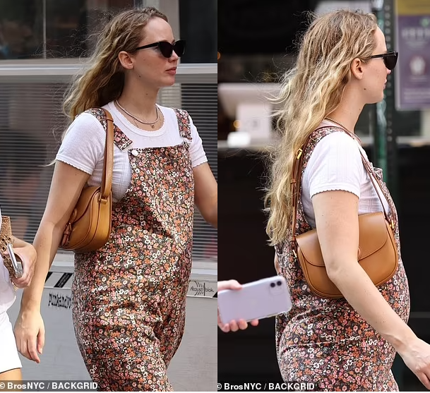 Jennifer Lawrence debuts baby bump as it's revealed she's expecting first child with husband Cooke Maroney