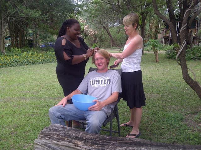 braiding Liles' hair in Shakawe