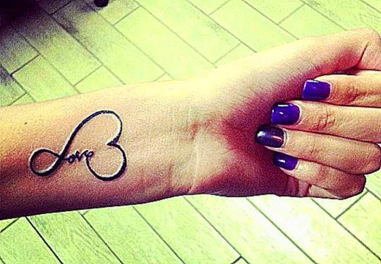 love tattoo on hand