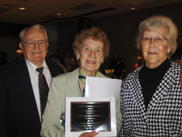 Lifetime Volunteer Leadership Award presented to Betty and David Bradbury by the MI Week Committee, 2010