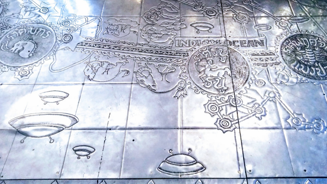 Travel writer discovers Flying Saucers etched or carved into Temple in Thailand.