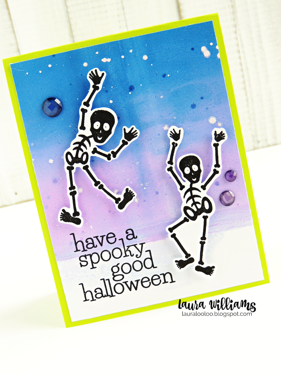 This handmade Halloween card begins with some of the sweetest skeletons you'll ever meet! I started with a piece of white cardstock that I inked up using re-inkers on my Gel Press. Then, I embossed the skeletons in black on white cardstock and fussy cut them to pop them up on my card base. They are funny and funky and they make me smile!