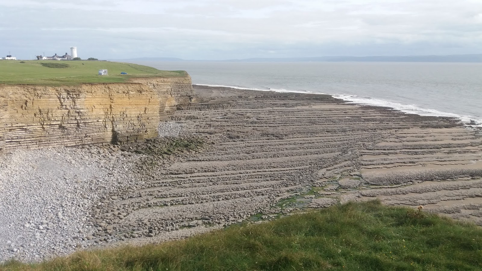 20170824 161504 Nash point, striated cliffs, and and rock patterns on beach below