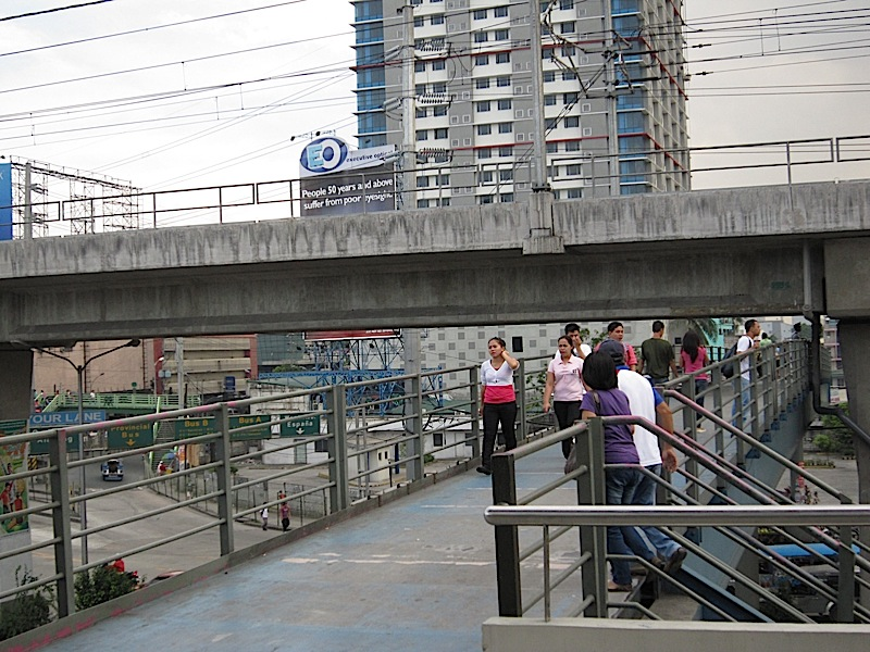 MRT track over a footbridge over EDSA