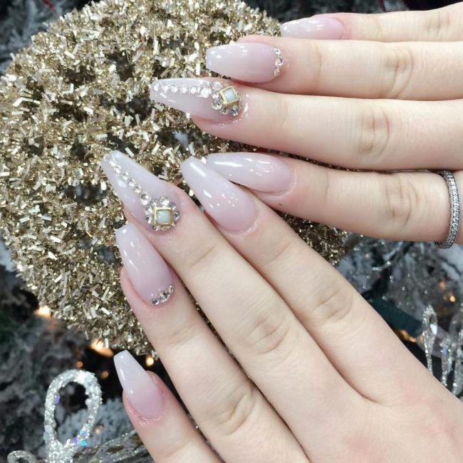 The squared off end of the nails compliment the simple nature of the design.  diamond ... - Sparkly Ideas For Diamond Nails - Styles Art