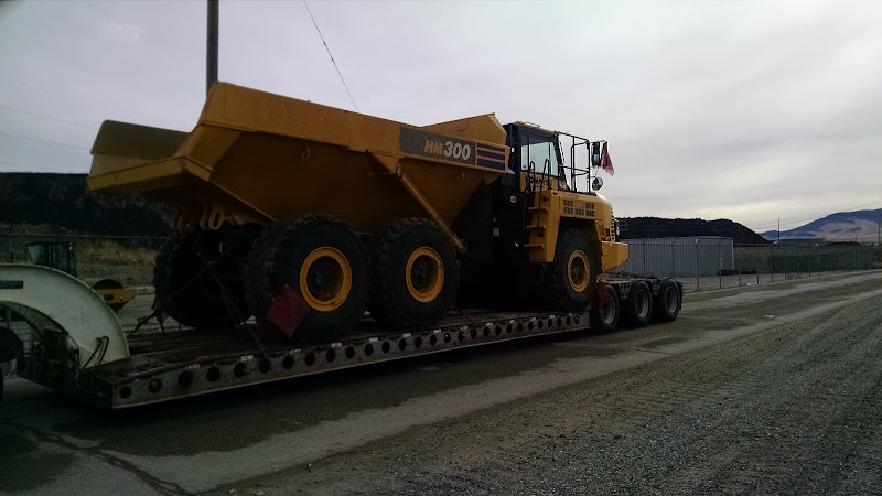 Komatsu HM300 dump truck loaded on flatbed