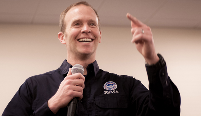 FEMA Administrator Brock Long speaks at an Agency-wide Town Hall regarding the Strategic Plan and the future of FEMA. He was appointed by Trump and denies the results of climate science. Photo: Colt Hagmaier