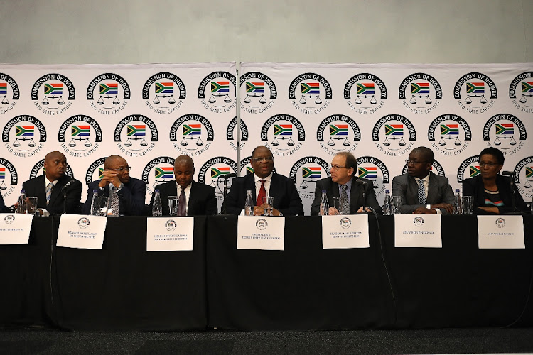 Deputy chief justice Raymond Zondo, centre, outlines progress in the state capture inquiry, in Johannesburg in May 2018. Hearings begin on Monday, August 20 2018. Picture: ALON SKUY