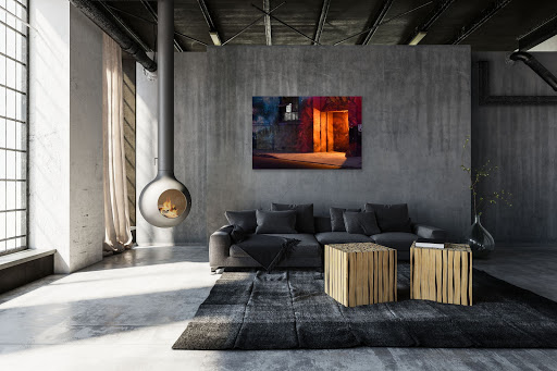 Arts District photography hangs in industrial interior design style living room