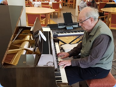 George Watt playing the Schimmel grand piano