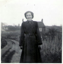 Jean West in front of the Brickyard House