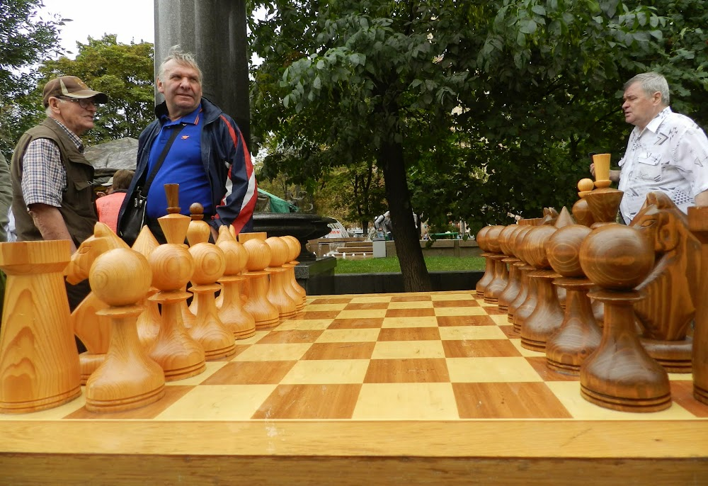 old men set up for another game of outdoor chess