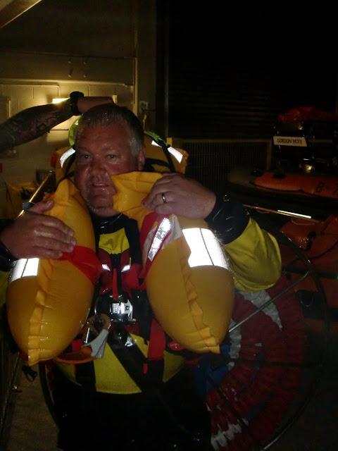 31 May 2012 - ALB Coxswain Jonathan Clark with lifejacket inflated. Photo: RNLI Poole/Dave Riley