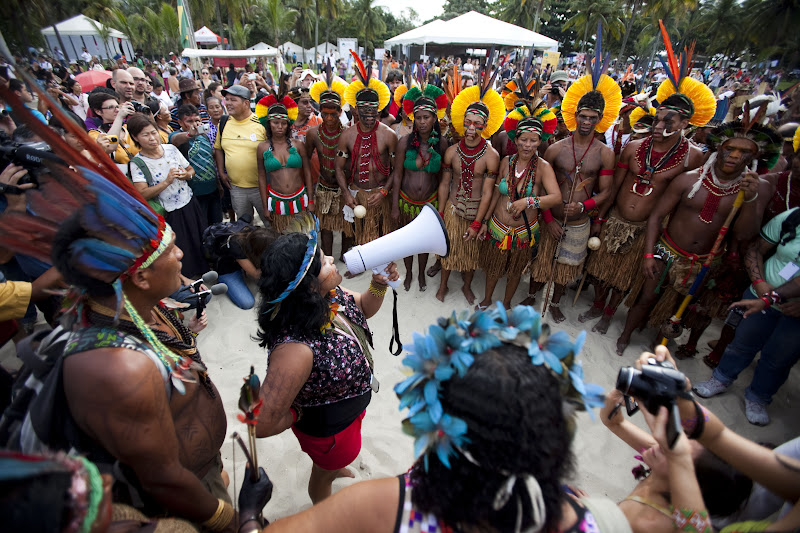 Sonia Bone Guajajara, VP of  the Coordination of the Indigenous Organizations of the Brazilian Amazon (COAIB), addresses indigenous marchers on Rio's Flamengo Beach on June 19, 2012. ©Caroline Bennett