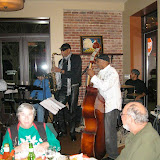 "The weather outside was frightful, but the music was delightful! Despite freezing temperatures on this December night, the first JSOP ""Blue Monday"" packed the house at the Five Sisters Blues Café. The crowd included a large number of Jazz Society members, as well as many who were introduced to the Jazz Society for the first time. Bassist Edmo Lanier led the group, which included saxman Ike Bartley, pianist Burt Kimberl, and drummer Don Tucker. Featured guests included ""Stan The Blues Man"" Ernie Stanberry, vocalist Lionel C., and vocalist Tomato. Also sitting in during the evening were vocalist/pianist Crystal Joy Albert, vocalist Gwen D'Vyne, trumpeter Roger Villines, and vocalists Erma Granat and Kathy Lyon. The enthusiastic crowd clapped, cheered, danced and joined in on some of the tunes, with every seat in the Fives Sisters filled, with some audience members standing in the back."