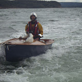 16 August 2014 - Poole ILB towing a sailing dinghy after it had capsized in gusty winds. Photo: RNLI Poole/Dave Riley